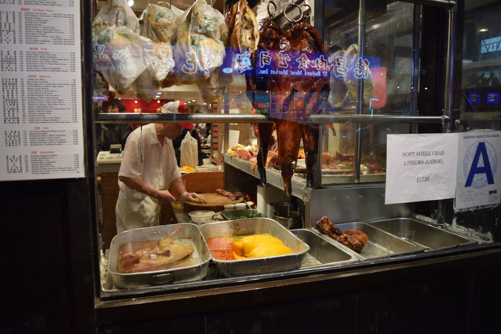 Photo of Yee Li Restaurant - New York, NY, United States. Chopping duck.